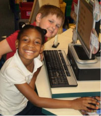 Photo of two students conducting internet projects